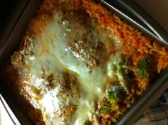 Cheesy chicken, broccoli & rice bake. My version: uncooked rice and tomato soup, mixed well. Top with seasoned chicken breast (I used mesquite seasoning), broccoli and cheese. Bake at 375F for 45 mins or so.