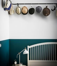 Different hats are hung from an IKEA HUGAD curtain rod with IKEA ENUDDEN hangers with clips.