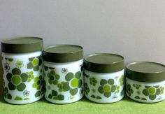 Anchor Hocking Green and White Milk Glass Canisters, Avocado Green Floral Canisters, Mod Retro Flower Canisters/Jars, Set of Four by EastWestVintage1 on Etsy https://www.etsy.com/listing/450151512/anchor-hocking-green-and-white-milk