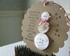 Handmade Christmas snowman ornament using buttons and bakers twine
