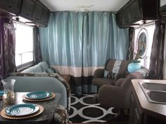 #7 of RV remodel  1986 Winnebago gets total interior update using dark chocolates  aqua/blues, cabinets were painted dark brown, flooring was replaced with inexpensive laminate flooring, curtains hung behind the driving cabin, painted outdoor rug in a geometric pattern giving space a modern touch; this can be done  so cute.. DIY Glam RV Remodel with Tufted Wall