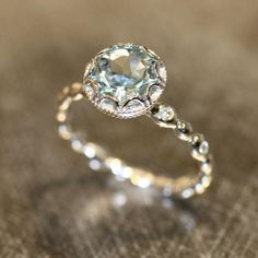 24 pretty engagement rings under $1,000, including this aquamarine beauty...pinned by ♥ wootandhammy.com, thoughtful jewelry.
