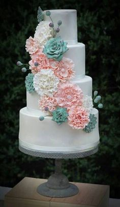 Beautiful wedding cake with flowers.  Are you looking to buy or sell a home in the beautiful Okanagan Valley  Region of British Columbia?  Our Real Estate Experts will find you the perfect family home, investment property, rural lot, acreage or lakefront vacation home to suit your needs. Century 21 Realtors in Vernon, Kelowna, Shuswap, Spallumcheen, Armstrong, Enderby and Salmon Arm.