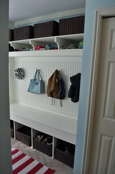 Laundry room organization & seating - opposite wall of washer and dryer!