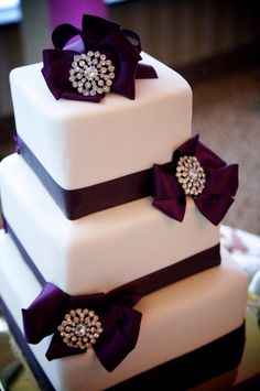 deep purple ribbon cake with crystal accents!