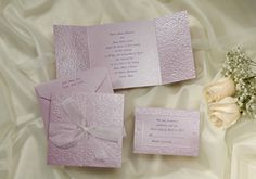 This square gatefold invitation is heavily embossed purple stardream paper with a matching purple stardream envelope.