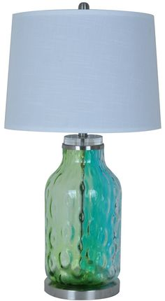 """Create a captivating coastal style with this blue glassSea Breeze Table Lamp 31.5""""""""H with a metal base.A white linen shade completes the look.  Shade Dimensions:16 x 16 x 10 White Linen Shade Tur"""