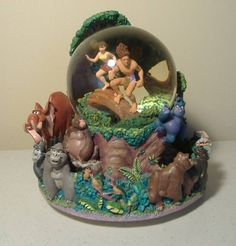 RARE Disney Tarzan & Jane Rotating Musical Snow Globe Two Worlds music box Walt
