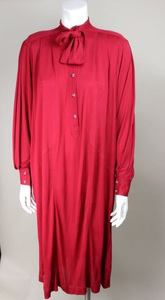 """""""Loose and fluid 1980s dress. Defined slightly pleated shoulders. Drapey sleeves end in buttoned cuff, pockets hidden in seams."""" 100% rayon. Priced at $595 US. Offered by Screaming Mimis at  https://www.1stdibs.com/fashion/clothing/day-dresses/"""