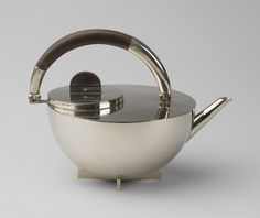 Designer: Marianne Brandt Product: Tea pot. Material: Silver Date: 1924 Description: The Marianne Brandt tea pot is the piece of the set, which most entirely takes after the formal standards of the Bauhaus school. Circle, globe and square are the essential types of the development. http://www.tecnolumen.com/42/Marianne-Brandt-Tea-pot.htm