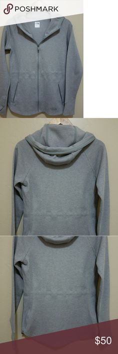 The North Face gray sweater The North Face gray zip up sweater with hoodie new with out tags The North Face Sweaters