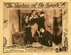 #28 'The Shadow of the Eagle', 1932 Mascot film serial, starring John Wayne as Craig McCoy, carnival stunt pilot, in his first of 12-chapter serial role, with Dorothy Gulliver. Mysterious pilot, The Eagle, attempts to sabotage a local company & sends threatening messages via skywriting. This serial is now in the public domain.