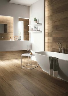 Uber contemporary bathroom with timber floor and walls
