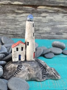 Miniature lighthouse on rocks OOAK ceramic by theCherryHeart
