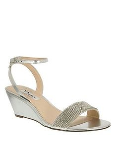 "<ul> <li>Party-ready wedge silhouette with a flash of sparkle</li>  <li>Covered wedge, 2.25""</li>  <li>Synthetic upper</li>  <li>Adjustable ankle strap</li>  <li>Leather sole</li>  <li>Padded insole</li>  <li>Imported</li> </ul>"