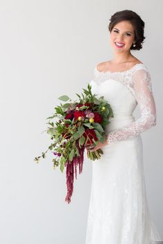 Spanish Shoot | Weddings in Tampa Bay | Red spanish style bouquet made with Red Roses, Dahlias, Red Hanging ameranthus and Eucalyptus greenery.  #andrealaynefloraldesign  #tampaweddings