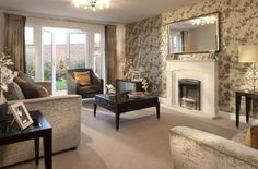 Interior Designed Living Room using a neutral colour scheme of taupes, minks, metallic wallpaper, bronze, creams and charcoal  accents (which ground the whole look). David Wilson Homes 2015.