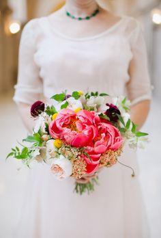 This romantic bouquet combines bright pink peonies with blush garden roses and craspedias