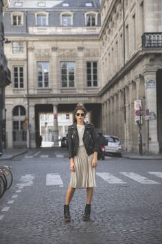 justthedesign:  Natalia Cabezasis rocking this authentic rocker chick style consisting of a pleated midi skirt sheer blouse and a classic leather jacket. Try this look with Chelsea boots for a fresh fall style.  Outfit: Zara.