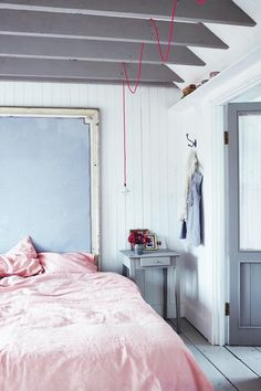 Feminine yet minimal bedroom with pendant lamp on a colorful cord