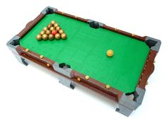 https://flic.kr/p/wXbHAF | LEGO Pool | I've been playing some Billiard lately and it inspired me to build my own pool table. Of course, I should have known better than to expect it to work just like a normal pool table. It is playable, but much more unpredictable than the real thing. Regular physics just don't apply to LEGO.   Also watch the video! (It's the best part.)  More pictures on MOCpages.