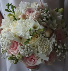 Romantic bridal bouquet styled with Sweet Avalanche by Meijer Roses. Designed by Green Room Flowers