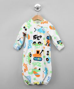 Little ones will treasure the assortment of different playtime jewels printed on this gown. A button-up collar works with the soft polyester and organic cotton fabrics to make slipping it on feel as fun as it looks.