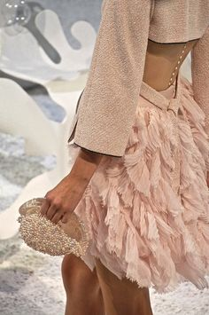 Chanel S/S 2012, pearls down the back - not something I would probably wear but I think it's so pretty