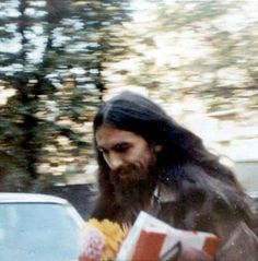 October 9th, 1970 - George Harrison bringing flowers and gifts to John Lennon for his birthday.