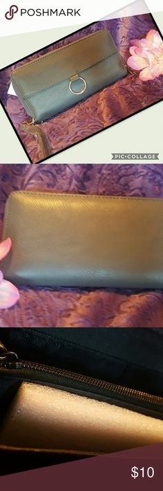"👜NEW GRAY WALLET👜 Awesome wallet with gold deco, in need of a new casual wallet, here it is.  👜Measures lenght  7 1/2""                   Width  1""                   Height 4""  👜 Love reasonable offers. ❎ NO TRADES  ❎ NO LOW BALLERS Bags Wallets"