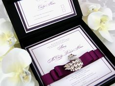stunning couture wedding invitation arrives in a black satin box with Czech crystal swan broach - talk about WOW factor!
