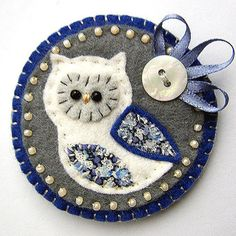 Owl Brooch inspiration-using patterned cloth for wings and unusual palette (smb: Another ornament idea too!)