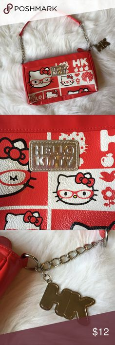 Small kids Hello Kitty purse Cute red and white lil girl Hello Kitty purse for your lil fashionista. Silver chain handles, and a HK charm. Like new from non smoking home. See pics for measurements Hello Kitty Accessories Bags