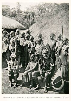 Wambugu wa Mathangani and his sixteen wives. This picture was part of a set of seven steriographic cards published and copyrighted by Underwood and Underwood in 1909 and was taken by James Ricalton in 1908/09 at Wambugu's homestead then located at Nyeri, Kenya. Wambugu wa Mathangani was a well known Kikuyu personage and man means a leader, muthamakii. He was later appointed as a Paramount Chief for that region by the colonial Government.