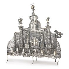 A Galician silver large filigree Hanukah lamp, mid 19th century | Lot | Sotheby'sSOLD. 13,750 USD