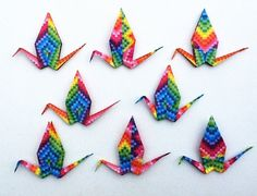 A set of 8 origami cranes each individually hand folded by me from a 6 x 6 inches / 15 x 15cm sheet of high quality geometric rainbow pattern Japanese origami paper. The set of 8 cranes includes 2 each of 4 different patterns, please see photo 4 for all the 4 patterns. As each crane is individually hand folded, tiny variations will occur. price 8.06$