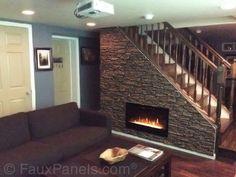 Dies ist eine clevere Idee, macht eines Raumes verwenden, das geht in der Regel ignoriert. Das Treppenhaus wurde ausgestattet mit Gas-Kamin und machte über mit faux geschichteten Steinen, evoziert das Gefühl eines traditionellen Kamins.