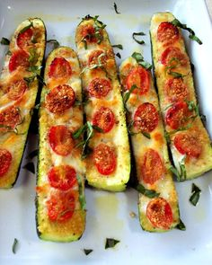 Zucchini Boats: cut a zucchini in half lengthwise and trim a little off the bottom so it sit still in a baking dish*** Scoop out the center where the seeds are with a spoon*** Brush the surface with a mixture of crushed garlic, olive oil, salt and pepper*** Arrange halved grape tomatoes into the grooves, sprinkle with bread crumbs and bake in a 350 degree oven for about 30 minutes*** Remove and place diced fontina or mozzarella in between the tomatoes, place them back in, but now under the b...
