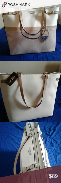 Guess purse This large handbag is a genuine GUESS. The bag is split done the middle with a beige leather strap to match its handles. The top half is a pristine white leather. The bottom is a light pink cloth with a G pattern. Interior is generous open space with side pockets for personal space. For those that like cloth and leather bags why choose! Get this bag with both today ! Guess Bags Totes