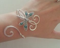 This Dragonfly bracelet Silver womens gift cuff emerald swarovski wedding elven bangle is just one of the custom, handmade pieces you'll find in our cuff bracelets shops. Dragonfly Jewelry, Copper Jewelry, Wire Jewelry, Body Jewelry, Jewelry Crafts, Sterling Silver Jewelry, Jewelery, Unique Jewelry, Jewelry Accessories
