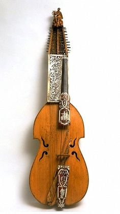 Baryton Germany about 1720 Carved sycamore, planed pine and sycamore, engraved ivory and tortoiseshell veneer Length 133 cm (total)Length 70 cm (belly)Depth 14 cmWidth 19 cm (Upper bout)Width 23.5 cm (Lower bout) 1444-1870  Copyright  Victoria and Albert Museum