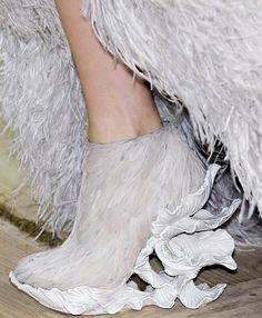 on the wings of Alexander McQueen