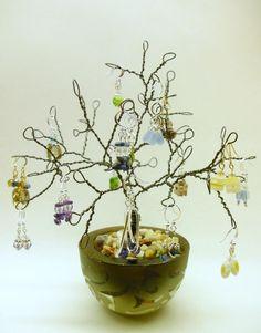 """Wire Earring Holder, Earring Tree, Earring Organizer, Earring Rack, Earring Display, Jewelry tree - """"Until Money Grows on Tree"""". $19.99, via Etsy."""