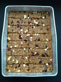 Homemade Chewy Granola Bars    1 cup brown sugar  2/3 cup peanut butter  1/2 cup corn syup  1/2 cup butter, melted  2 tsp vanilla  3 cups quick oats (not instant)  1/2 cup coconut  1/2 cup sunflower seeds  1/3 cup wheat germ  2 tbsp sesame seeds  1/2 – 1 cup chopped dried fruit (I did about 1/2 cup dates, 1/2 cup craisins, a bit of apricots)  1/2 cup chocolate chips (I found the original 1 cup to be too much… even though it's chocolate!)  bake at 350 F for 20 mins