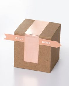 """This packaging job is a total breeze, even for the least crafty types. Simply attach our """"Pull Here"""" tab to a brown box with a strip of copper foil tape."""