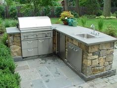 Builtin grill on paver patio by Bahler Brothers with space to