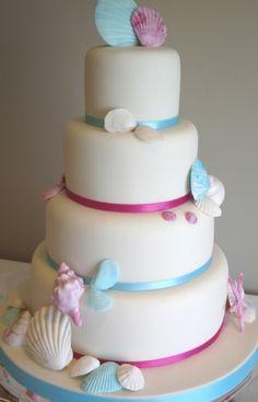 Mocha sugar shells wedding cake. Beach wedding cake