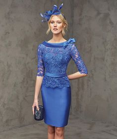 FALCA- Mikado silk, lace and tulle mermaid dress with elbow-length sleeves. Lace bodice with bateau neckline and decorative bias band with a bow at the neck and a mikado silk belt. Plunging 'V' back. Straight mikado silk skirt. Short dress for afternoon wedding.