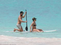 In charge: While Jennifer sat on the front of a paddleboard, Justin took control on his kn...