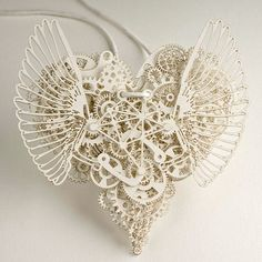 """From """"Art: Textiles&Paper"""": Clockwork Love -  paper cut art made by Tjeb."""